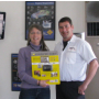 Ken & Robin Comforto.  The quarterly drawing winner of a Nikon Cool Pix 3100 kit with case and memory card.